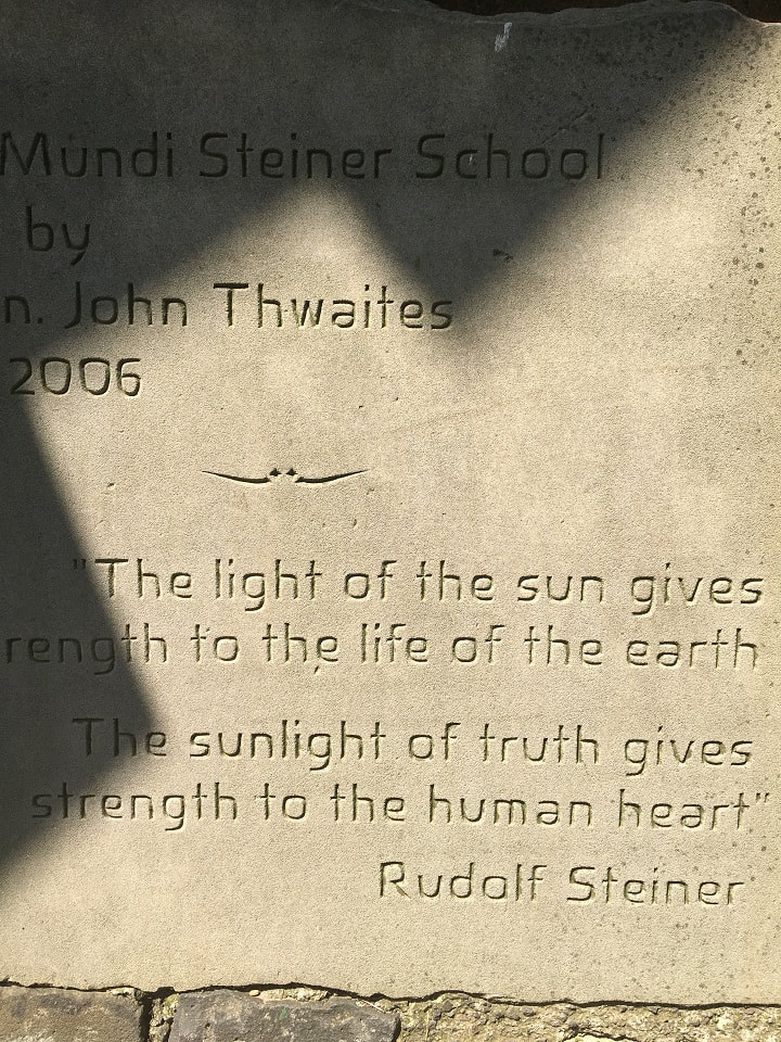 Rudolf Steiner quote carved in stone 'The light of the sun gives strength to the life of the earth.  The sunlight of truth gives strength to the human heart'.