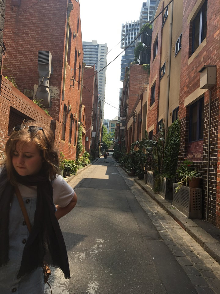 Inner city Melbourne alley with plants and girl in forground